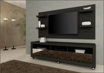 mounted TV on a wall with table under